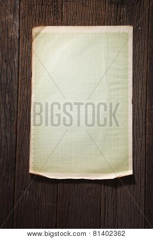old paper stick on wood background