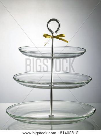 three tier plate on the with little ribbon