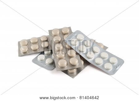 Pile of blister bubble pack pills isolated
