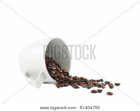 Spilled coffee beans from the cup isolated