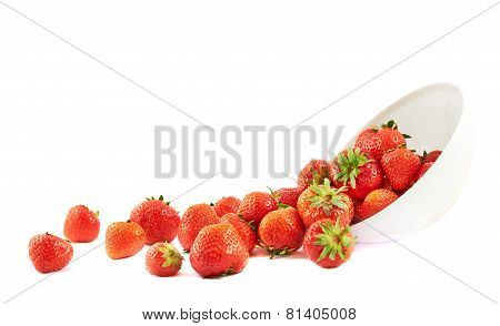 Scattered strawberries in a bowl