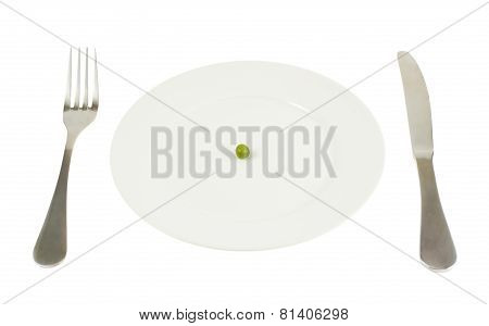 Plate with a single green pea isolated