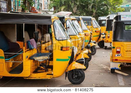 CHENNAI, INDIA - JULY 25, 2009: Indian auto rickshaws in street. Auto rickshaws (aka