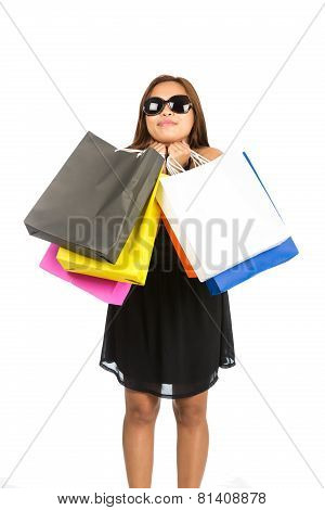 Asian Female Hugging Shopping Bags Head Tilted