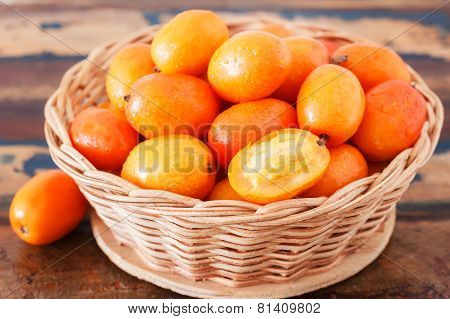 Fruit Jocote ( Siriguela, Red, Purple Mombin, Sineguela, Hog Plum, Ciruela Huesito) In Wicker Basket