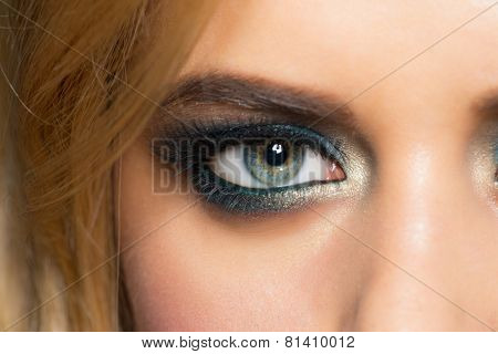 Closeup image of beautiful woman eye with fashion  makeup