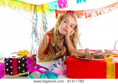 Bored gesture blond kid girl in party with chocolates and puppy chihuahua dog