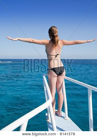 Woman Sunbathing On The Ship