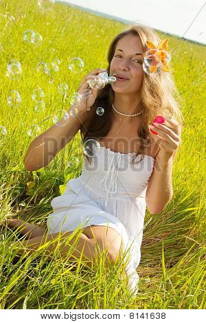 Girl In White With Soap Bubbles