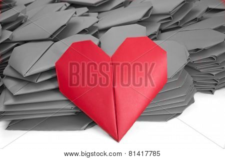 One Red Paper Heart In A Pile Of Grey Ones For Valentine's Day