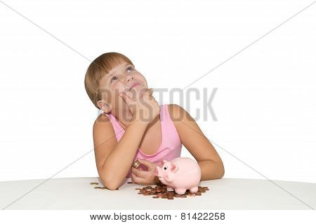 Thoughtful  Girl With Piggy Bank Isolated
