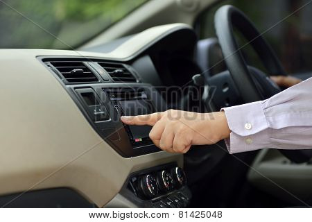 Man Driving His Car And Turn On The Radio
