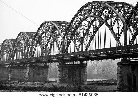 The Gerola bridge, over Po river. Black and white photo
