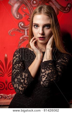 Girl On Red Wall In Black Dress