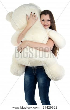 Standing teenage girl with white teddy bear