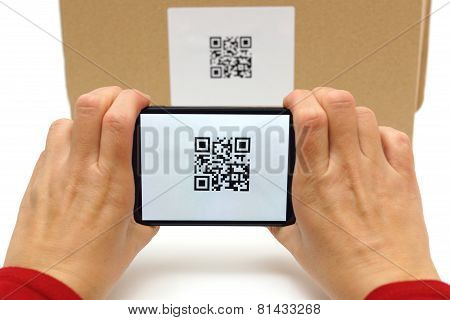 Woman Scan Qr Code On Box