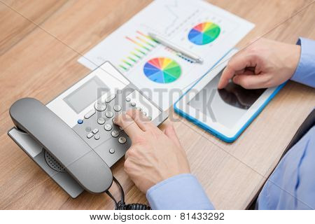 Busy Businessman With Report Is Pressing The Number On The Telephone Keypad And Working On Tablet Co