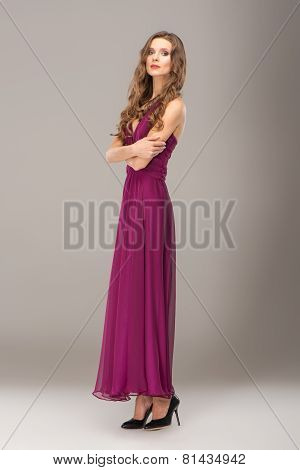 Young woman with curly hair wearing evening dress