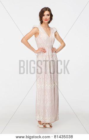Beautiful young woman wearing white evening dress