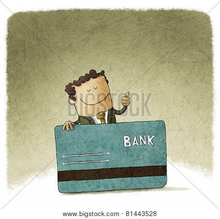 businessman showing his debit card