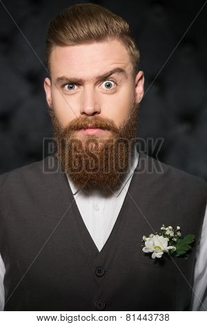 Serious looking stylish man with beard