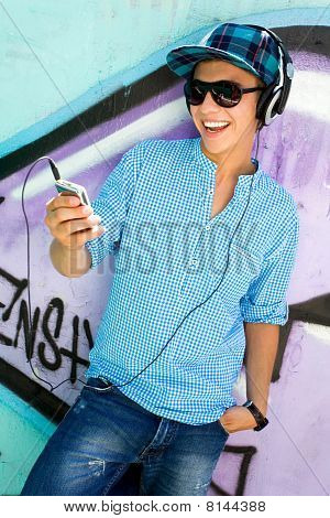 Young man with mp3 player
