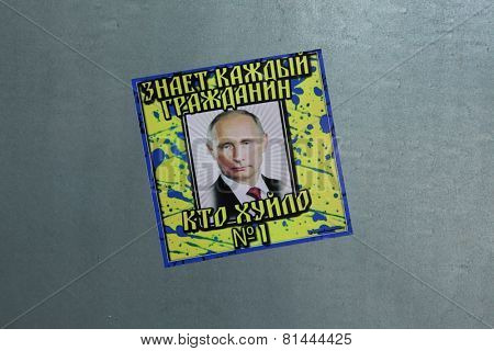 VIENNA - JUNE 27, 2014: Sticker depicting Russian president Vladimir Putin seen in Vienna, Austria. Russian verse on the sticker means: Every citizen knows who is a dickhead (khuilo) number one.