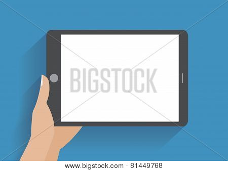 Hand holding tablet with blank screen