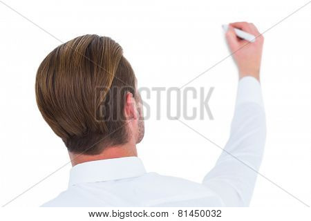 Rear view of businessman writing with marker on white background