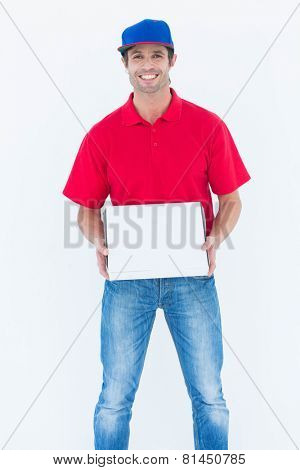Portrait of happy delivery man holding pizza box on white background