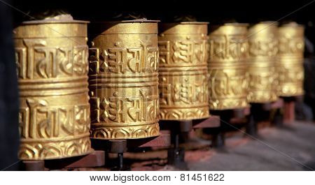 Golden Buddhist Prayer Wheels