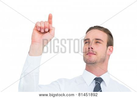 Cheerful businessman pointing with his finger on white background