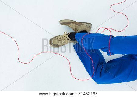 Low section of electrician wrapped with wire on white background