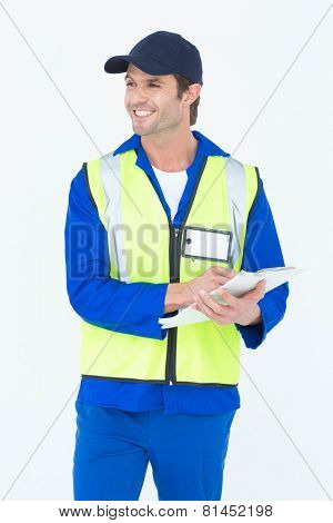 Happy supervisor writing notes on clipboard over white background