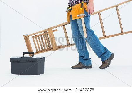 Low section of repairman carrying ladder on white background