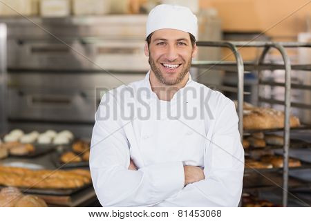 Smiling baker looking at camera in the kitchen of the bakery