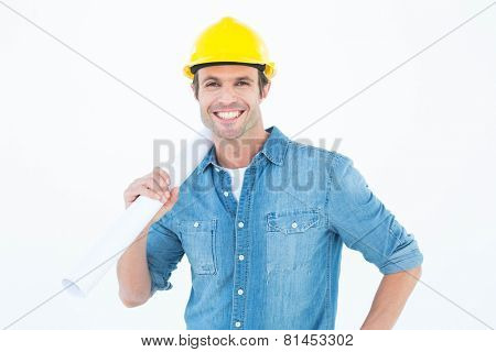 Portrait of confident architect holding rolled blueprint over white background