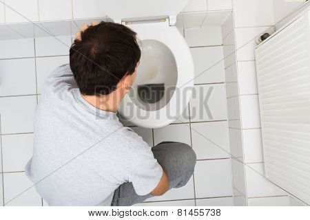 Man Vomiting In Bathroom