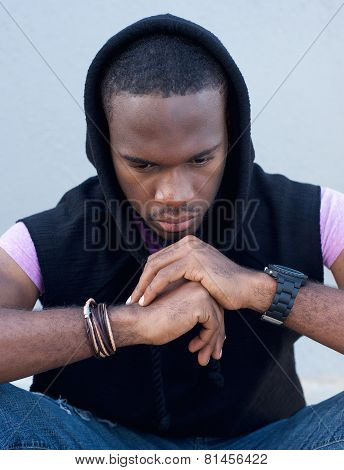 Young Man Sitting Is Hand On Chin Thinking