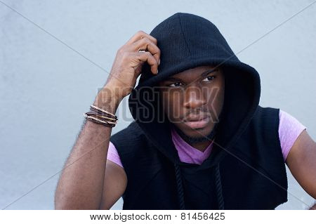 Handsome Young Man Sitting Outdoors With Hooded Sweatshirt