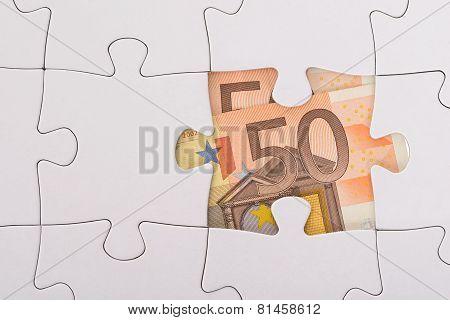 Euro Banknote Hidden Under Jigsaw
