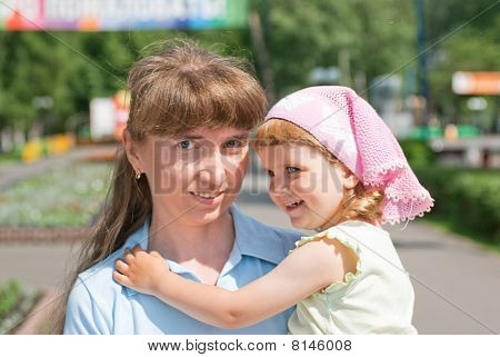 A Little Girl With Her Mother