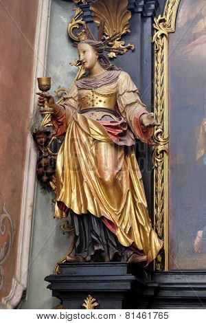 ST. WOLFGANG, AUSTRIA - DECEMBER 14: Saint Barbara on the altar of St. Anne in Parish church in St. Wolfgang on Wolfgangsee in Austria on December 14, 2014.