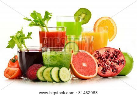Glasses With Fresh Organic Vegetable And Fruit Juices On White