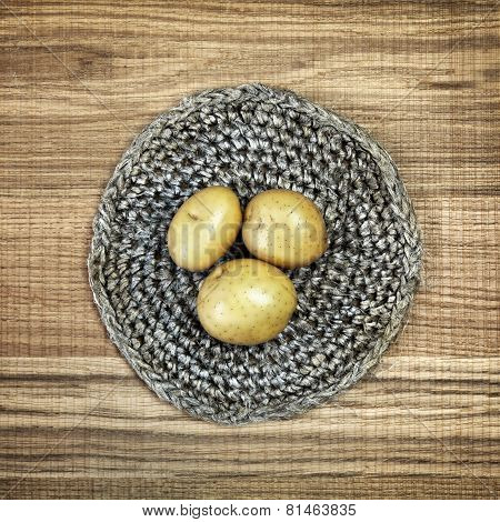 Beautiful Decoration With Fresh Potatoes On Linen Doily.