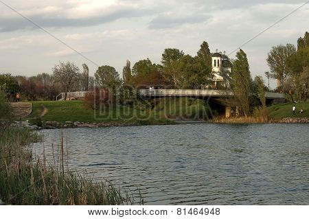 Small dam and christian church in the  residential district Drujba