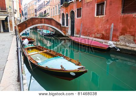 Gondolas Parked In Water Canal