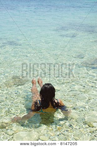 A woman relaxing in the sea