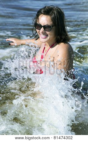 Pretty woman in the sparks of water