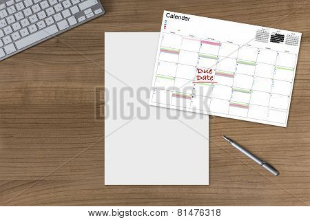 Calendar Due Date And Blank Sheet On Wooden Table